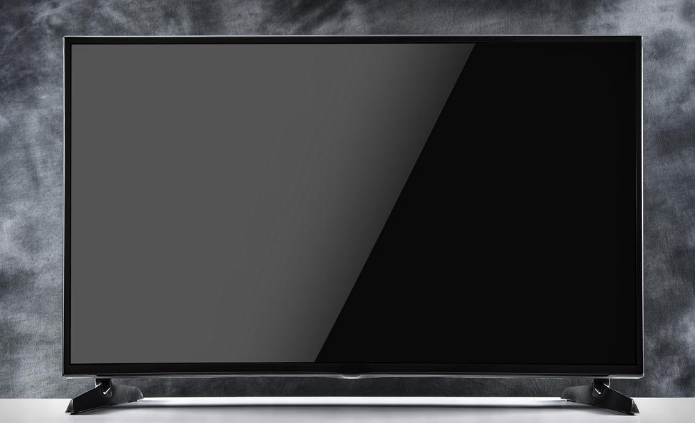 تلفزيون مثبت على حائط أسود